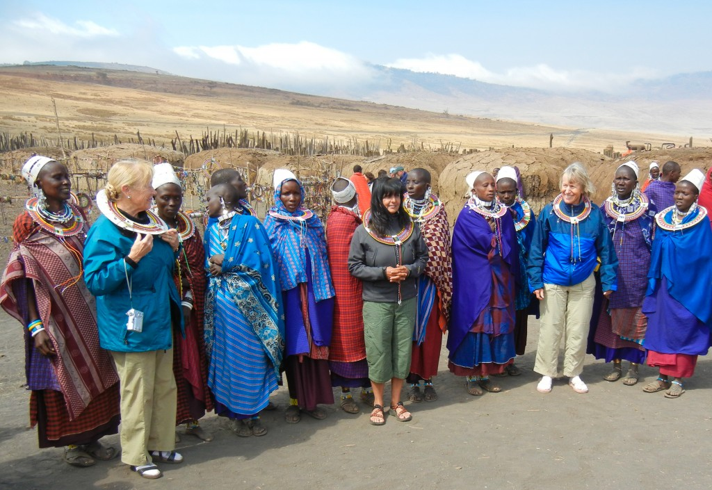 Rachel, Amber, and Betsy dance with Maasai women
