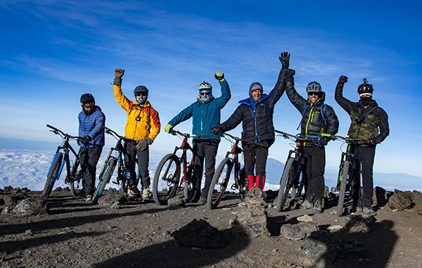 Team Kilimanjaro MTB ecstatic on the summit of Kilimanjaro