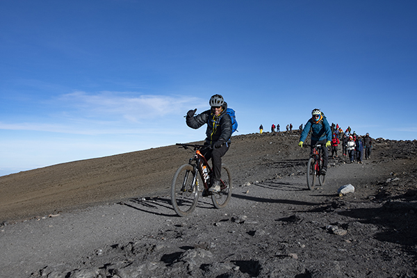 Riding from Uhuru Peak, the Roof of Africa