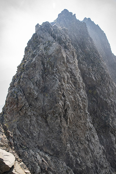 "The upper half of the Northwest Bill climbing in between the ""Rabbit Ears"" on the Northwest Arête"