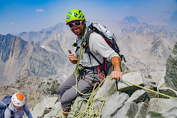 Tristan Sieleman on the summit of Devils Crag
