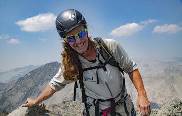Trevor Anthes arrives at the summit of Devils Crag