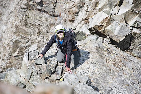 Paul Garry summiting Devils Crag